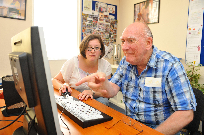 Photo of elderly man using a computer