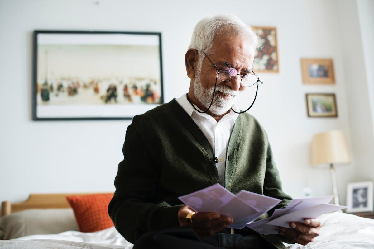 Senior Man Looking at Photos